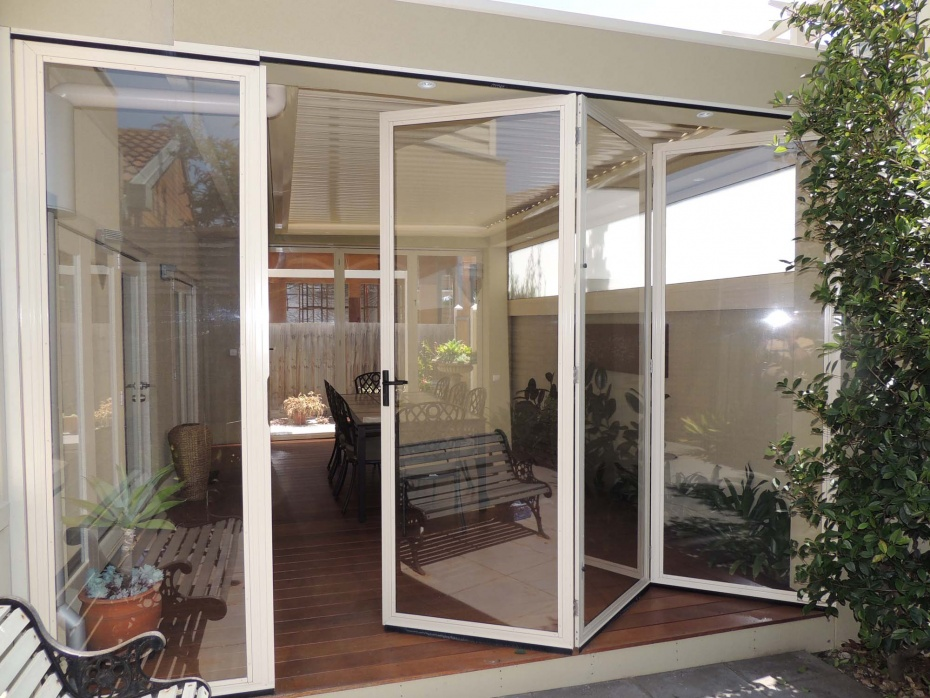 Concertina bi fold doors to screen out the weather in light weight PVC not glass