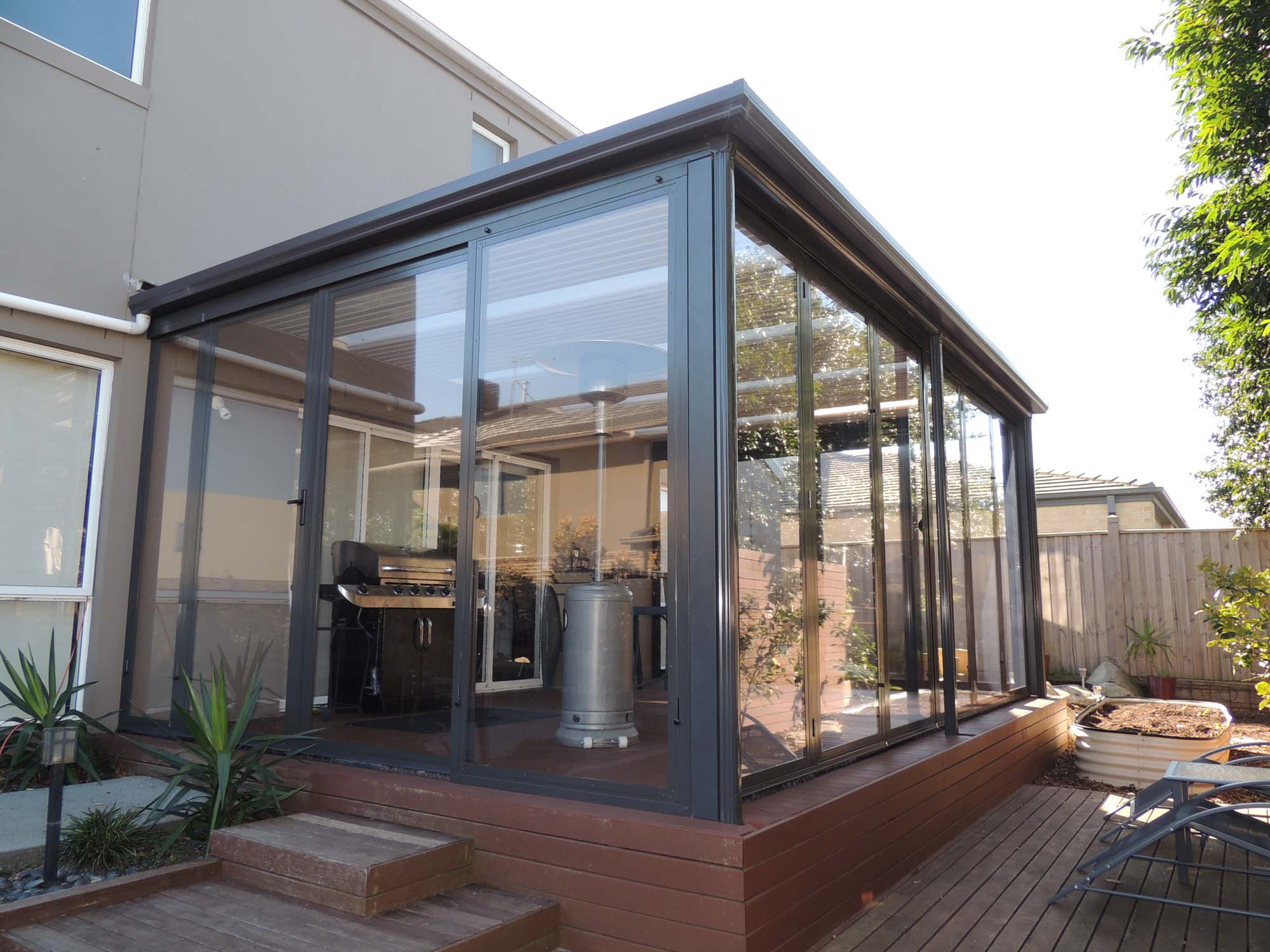 Bi fold Doors | Optiscreen | PVC Outdoor Screens Tinted or